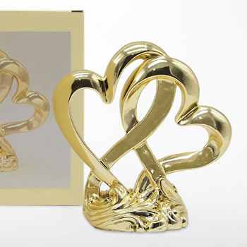 Metallic gold finished double heart cake topper and centerpiece