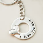 'I love you more' silver metal key chain with embossed heart design