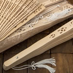 Intricately carved Sandalwood fan favors from Fashioncraft®