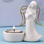Ceramic Angel candle holder with gold metal  wings from fashioncraft