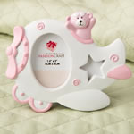 Pink Airplane design photo frame with adorable Teddy bear decoration.