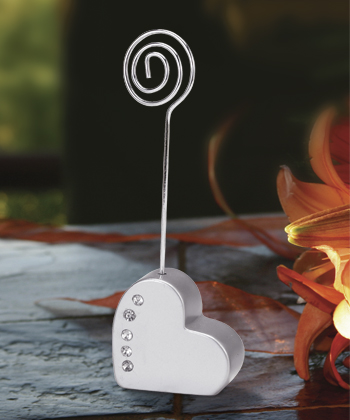 This deluxe heart shaped silver place card holder wedding favor
